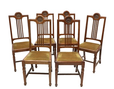 Lot 23 - A set of six oak dining chairs
