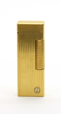 Lot 21 - A rolled gold Dunhill lighter