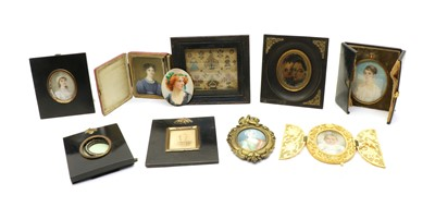 Lot 261 - A small group of ivory portrait miniatures