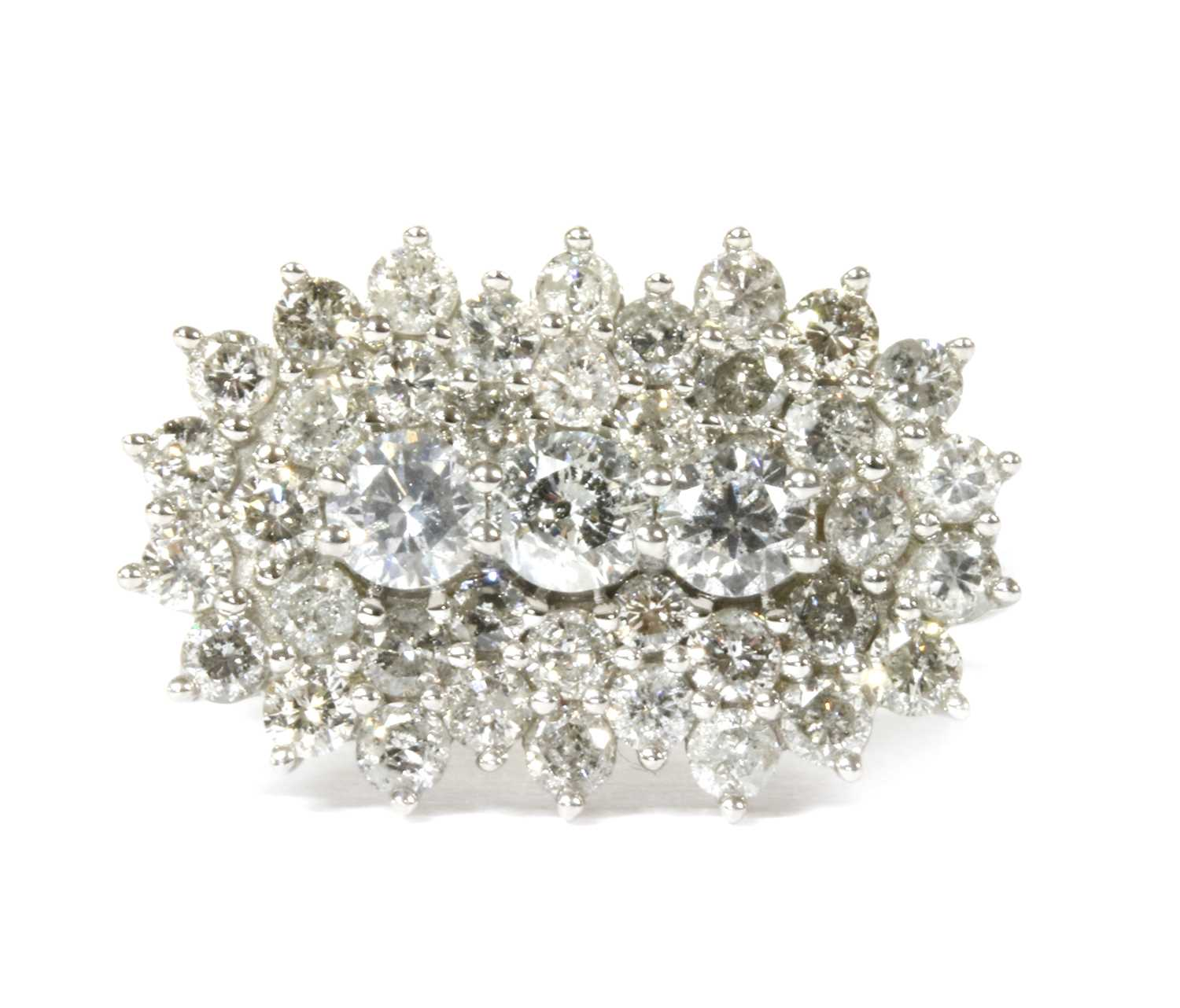 Lot 84 - A white gold diamond cluster ring