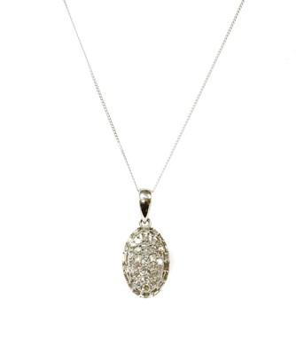 Lot 100 - A white gold diamond cluster pendant