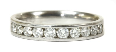 Lot 82 - A white gold diamond half eternity ring