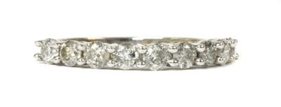 Lot 98 - A white gold diamond half eternity ring