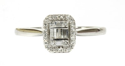 Lot 97 - A white gold diamond cluster ring