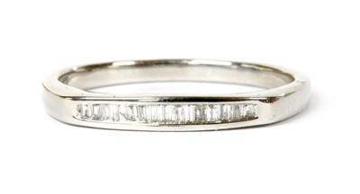 Lot 89 - A white gold diamond half eternity ring