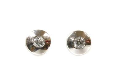 Lot 102 - A pair of white gold single stone diamond stud earrings