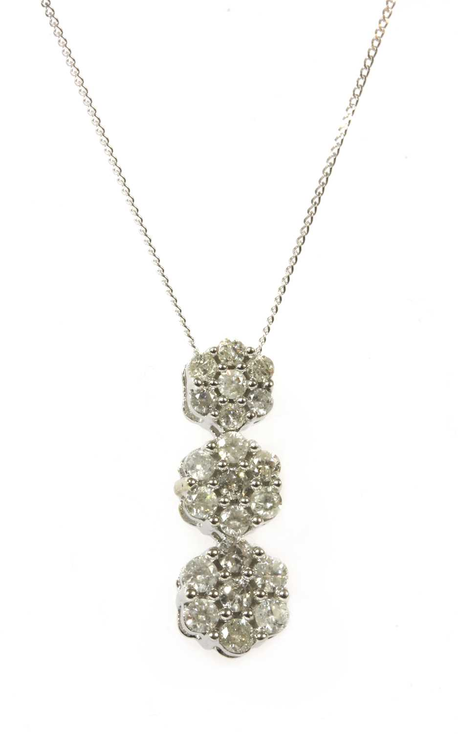 Lot 85 - A white gold diamond cluster pendant