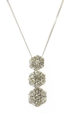 Lot 85 - A white gold diamond cluster pendant