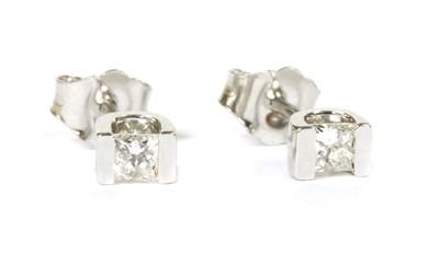 Lot 103 - A pair of white gold single stone diamond stud earrings