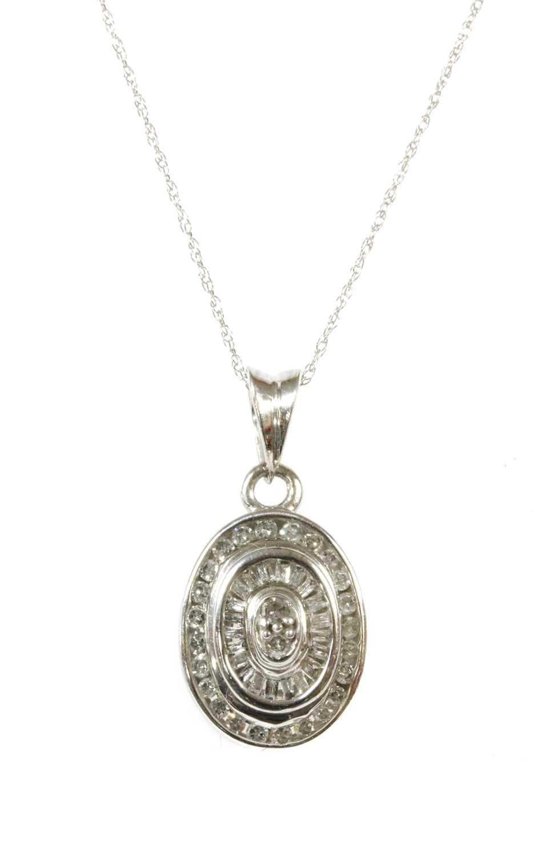 Lot 92 - A white gold diamond cluster pendant