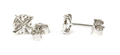 Lot 91 - A pair of white gold diamond cluster earrings