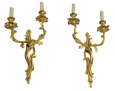 Lot 31 - A pair of French rococo-style gilt-bronze wall lights