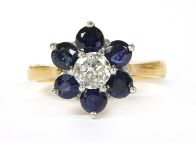 Lot 161 - An 18ct gold diamond and sapphire cluster ring