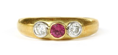 Lot 113 - An 18ct gold ruby and diamond three stone ring
