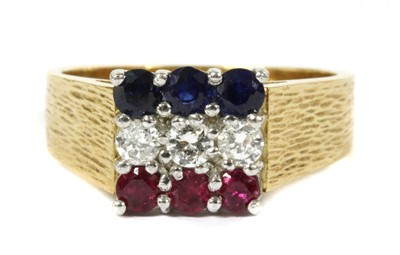 Lot 135 - An 18ct gold ruby, diamond and sapphire ring, c.1980