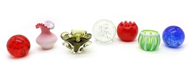 Lot 274 - Various glass items, comprising: three spherical bubbled doorstops