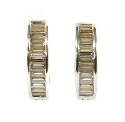 Lot 93 - A pair of white gold diamond set hoop earrings