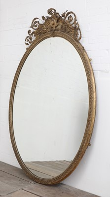 Lot 57 - A large gilt overmantel mirror
