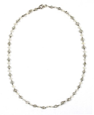 Lot 145 - A platinum diamond and seed pearl necklace