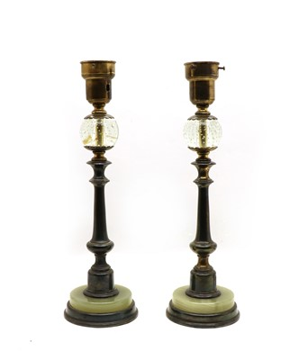 Lot 75 - An unusual pair of bronze onyx and glass table lamps