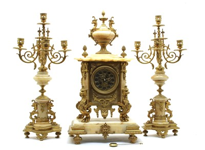 Lot 265 - A French ormolu and veined marble clock garniture