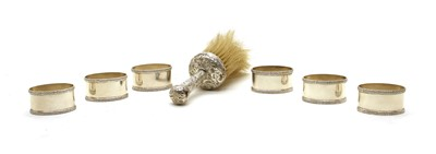 Lot 12 - A set of six silver napkin rings