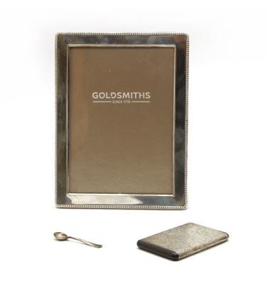 Lot 30 - An early 20th century white metal cigarette case
