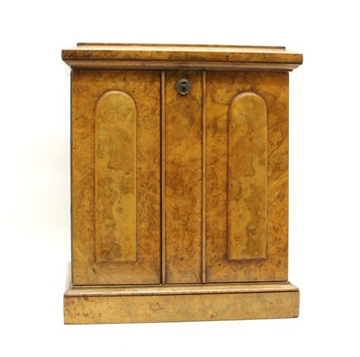 Lot 82 - A small Victorian walnut table top cabinet of drawers
