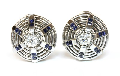 Lot 183 - A pair of white gold diamond and synthetic sapphire bombé earrings, c.1940