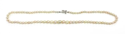 Lot 143 - A single row graduated natural saltwater pearl necklace
