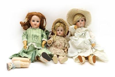 Lot 275 - Three bisque head dolls