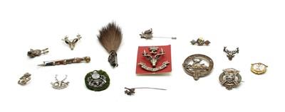 Lot 69 - Ten various metal brooches and cap badges