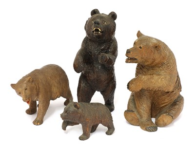 Lot 67 - Four carved wooden Black Forest bears