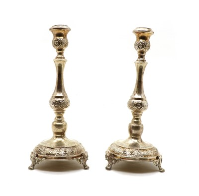 Lot 35 - A pair of Continental silver candlesticks