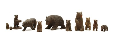 Lot 67 - A collection of ten small Black Forest and other carved wooden bears