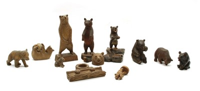 Lot 59 - A collection of eleven carved wooden Black Forest and other bears