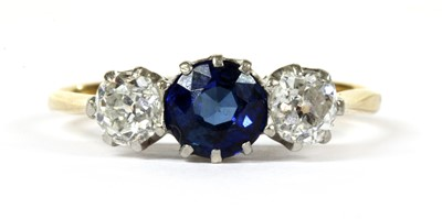 Lot 30 - A gold three stone sapphire and diamond ring