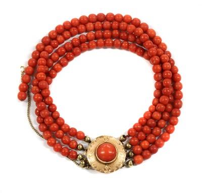 Lot 37 - A Dutch four row coral bead bracelet