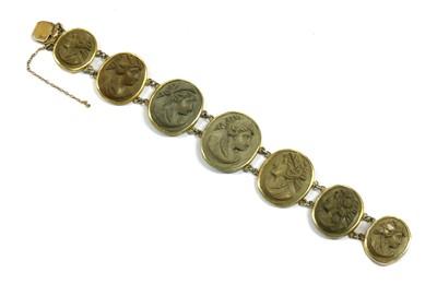 Lot 11 - A gilt metal lava stone cameo bracelet