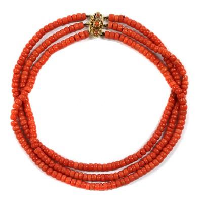 Lot 39 - A Dutch three row uniform coral bead choker necklace