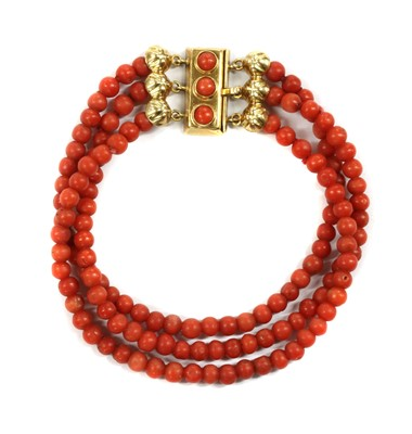 Lot 40 - A three row uniform coral bead bracelet