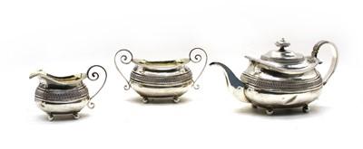 Lot 6 - A  Regency silver three piece tea service by Samuel Hennell, London