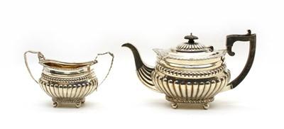 Lot 17 - A Late Victorian silver teapot & sugar bowl (2)