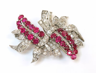 Lot 174 - A ruby and diamond double clip brooch, c.1935-1940