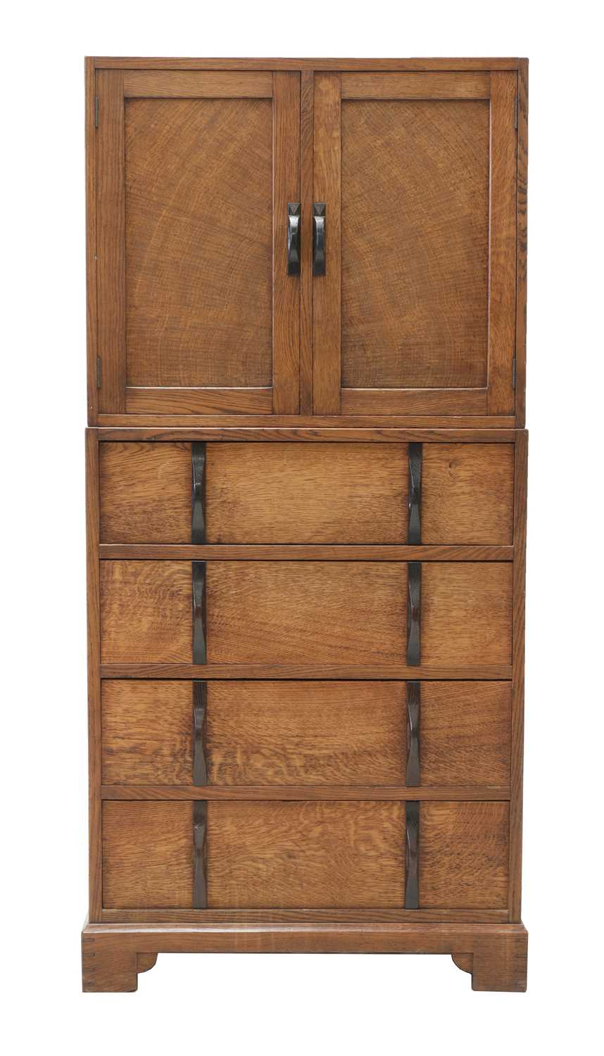 Lot 88 - A Gordon Russell oak two-part cabinet and chest