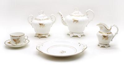 Lot 84 - A 19th century gilt and white tea set
