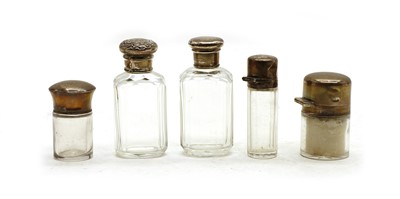 Lot 51 - A collection of silver-mounted cut glass dressing table bottles and jars