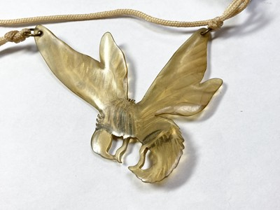 Lot 10 - An Art Nouveau carved horn pendant