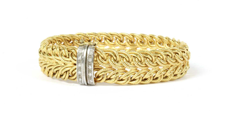 Lot 65 - A 9ct gold diamond set bracelet