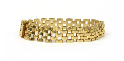 Lot 56 - A 9ct gold three row faceted panther link bracelet